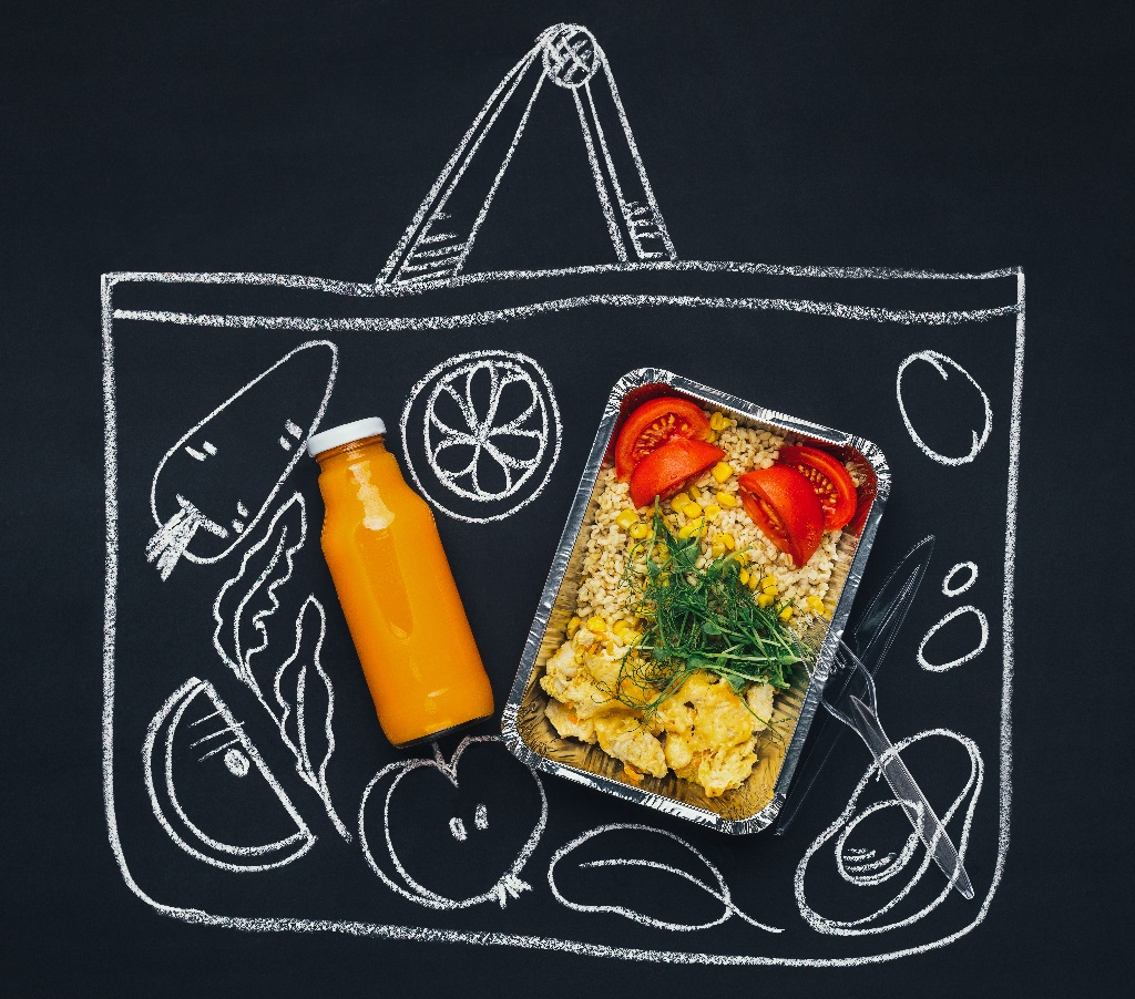 healthy food inside a chalk drawn lunch tote